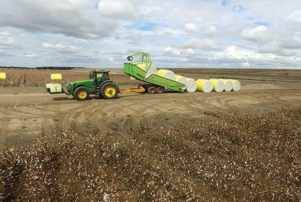 Bale Runner unloading 4 cotton bales